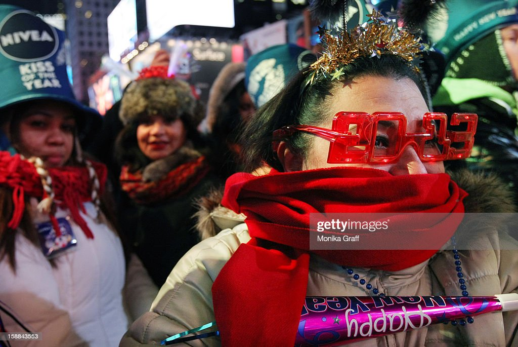 Yanny Borrero of Miami (R) joins the hundreds of thousands of revelers in Times Square to celebrate New Year's Eve on December 31, 2012 in New York City. Approximately one million people are expected to ring in the new year in Times Square.