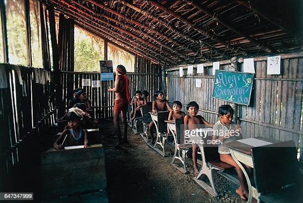 Yanomami children at their school desks The Amazon rainforest Venezuela