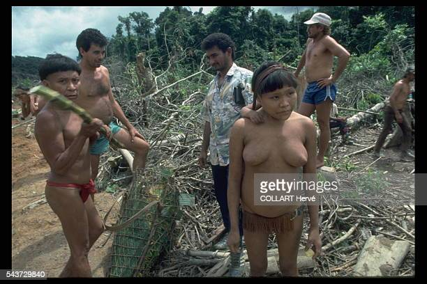 A Yanomami family experiencing their first contact with 'white men' gold miners who have come to the area looking for gold