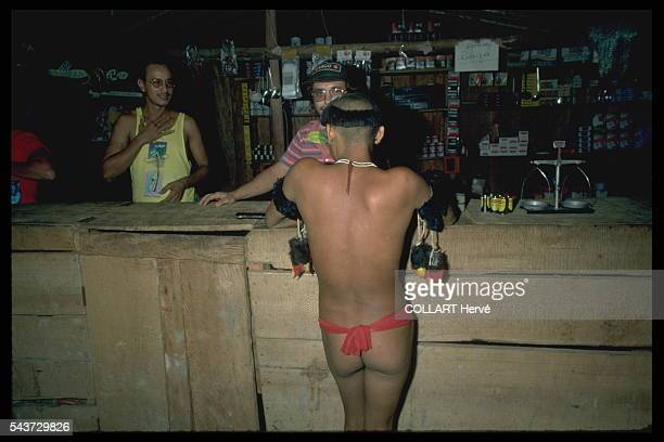 A Yanomami getting his first contact with 'white men' in the illicit gold mine's gambling den This is where the decline of the Yanomamis starts