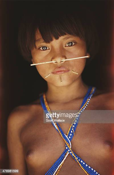 A Yanomami girl with pierced nose and cheeks at a village in the Amazon rainforest of Venezuela 2001