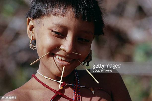 A Yanomami indian living close to the Amazon River in Brazil The Yanomami are an indigenous people of Brazil and Venezuela living under the...