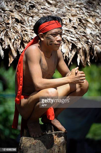 A Yanomami native man sits on a trunk at the Irotatheri community Amazonas state southern Venezuela 19 km away from the border with Brazil on...