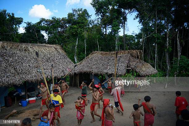 Yanomami natives perform a ritual dance at Irotatheri community in Amazonas state southern Venezuela 19 km away from the border with Brazil on...
