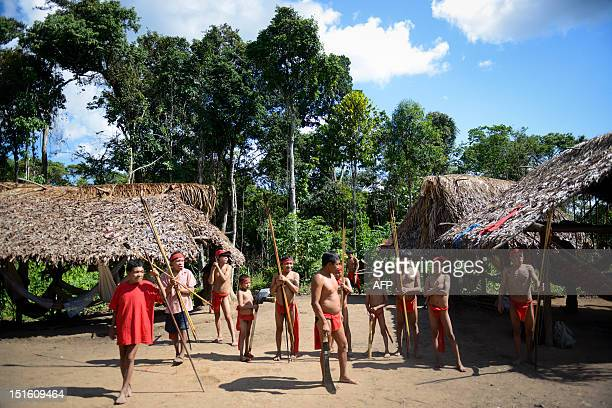 Yanomami natives prepare to perform a ritual dance at Irotatheri community in Amazonas state southern Venezuela 19 km away from the border with...