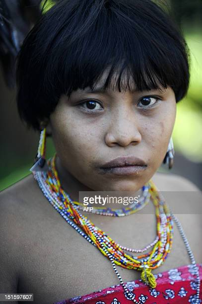 A Yanomami woman poses for a photo at Irotatheri community in Amazonas state southern Venezuela 19 km away from the border with Brazil on September 7...