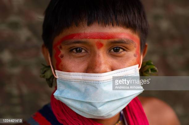 Yanomami woman wears protective mask to receive health care during the Yanomami / Raposa Serra do Sol Mission amidst the coronavirus pandemic at the...