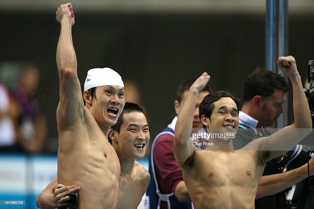 Yanpeng Wei, Xiabing Liu and Furong Lin of China cheer on teammate Yinan Wang in the Men's 4x100m Medley - 34 Points on day 10 of the London 2012 Paralympic Games at Aquatics Centre on September 8, 2012 in London, England.