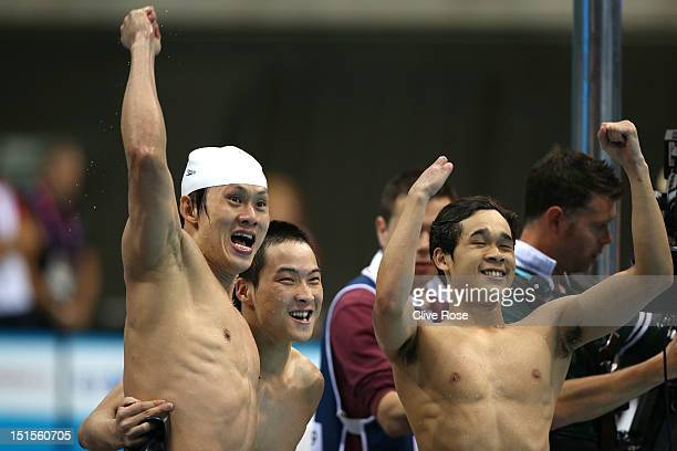 Yanpeng Wei Xiabing Liu and Furong Lin of China cheer on teammate Yinan Wang in the Men's 4x100m Medley 34 Points on day 10 of the London 2012...