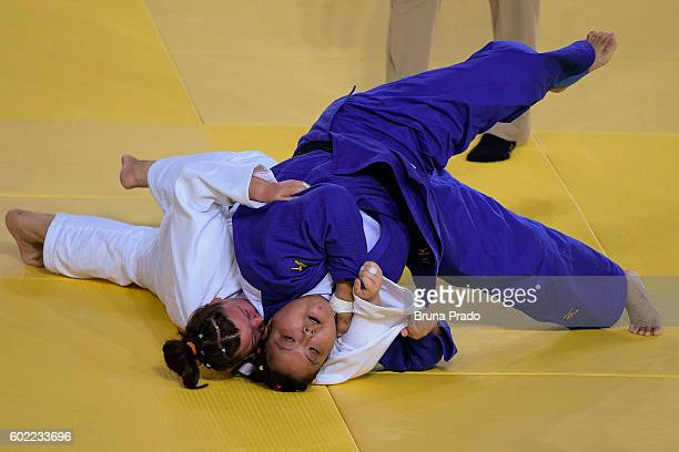 Yanping Yuan of China with Alimova Khayitjon of Uzbekistan during the Women 70 kg Judo Gold Medal match on Day 3 of the Rio 2016 Paralympic Games on...