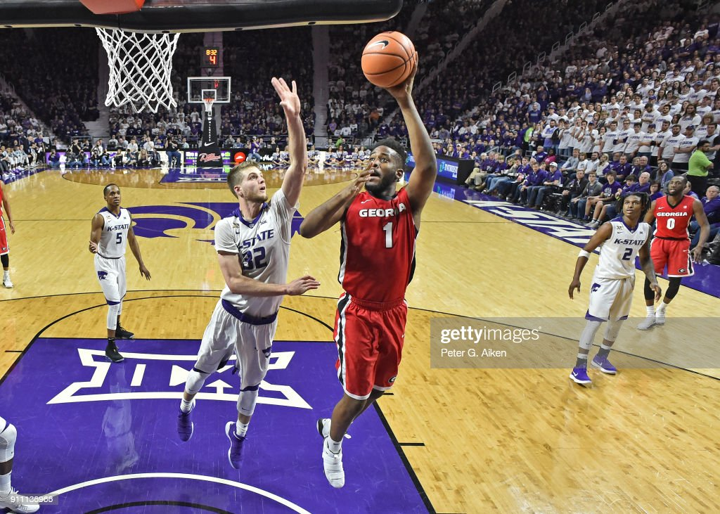 Yante Maten #1 of the Georgia Bulldogs drives to the basket against Dean Wade #32 of the Kansas State Wildcats during the second half on January 27, 2018 at Bramlage Coliseum in Manhattan, Kansas.