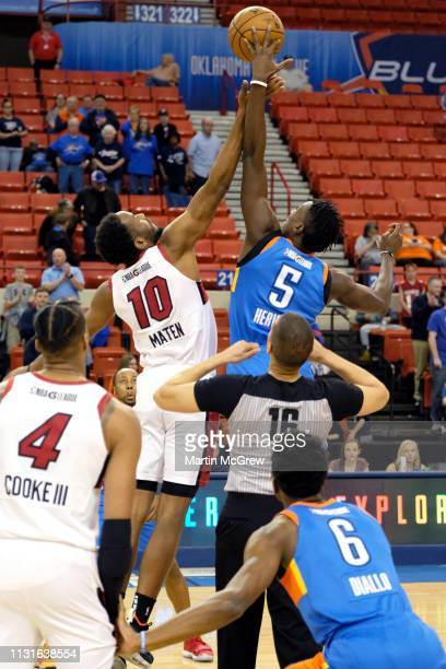 Yante Maten of the Sioux Falls Skyforce and Kevin Hervey of the Oklahoma City Blue jump for the opening tipoff during the NBA G League on March 19...