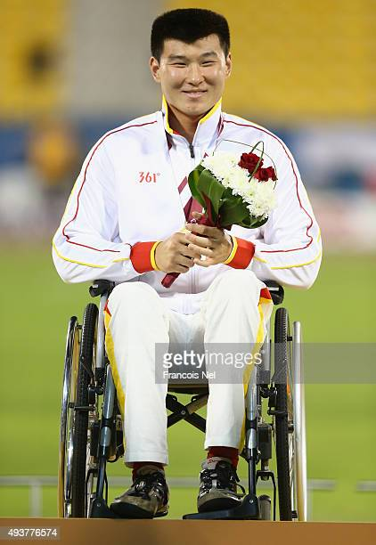 Yanzhang Wang of China poses with his gold after the men's javelin F34 final during the Evening Session on Day One of the IPC Athletics World...