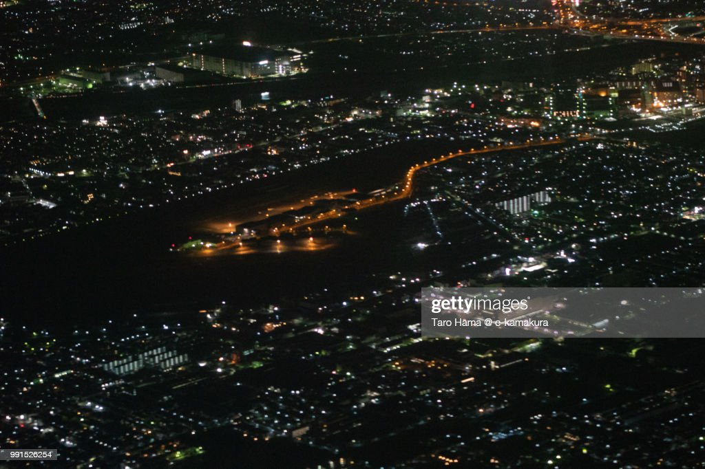 Yao Airport in Osaka prefecture in Japan night time aerial view from airplane : ストックフォト