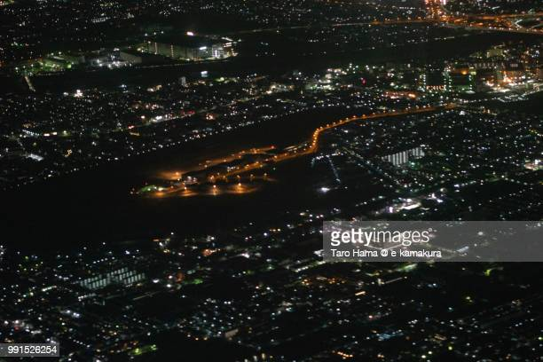 Yao Airport in Osaka prefecture in Japan night time aerial view from airplane