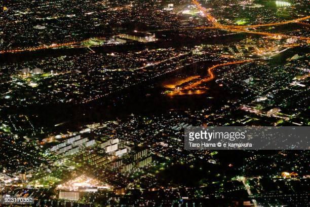 Yao Airport in Yao city in Osaka prefecture in Japan night time aerial view from airplane