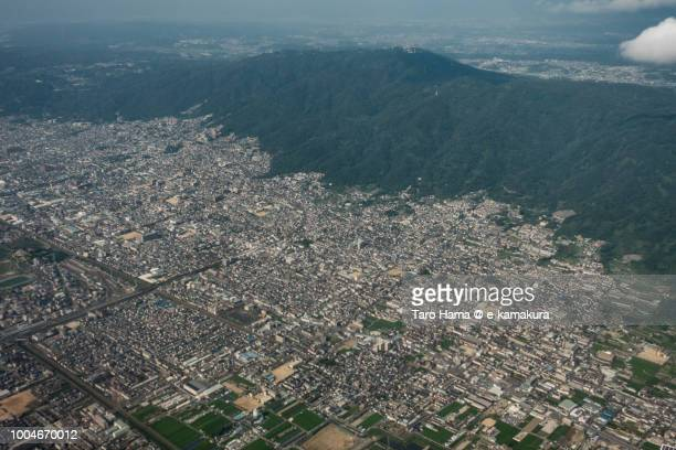 Yao and Higashiosaka cities in Osaka prefecture in Japan daytime aerial view from airplane