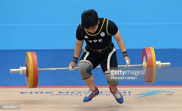 Yao Chi ling of Taiwan fails to lifts 106 kg in the women's 75kg weightlifting group A final of the 2014 Incheon Asian Games in Incheon on September...