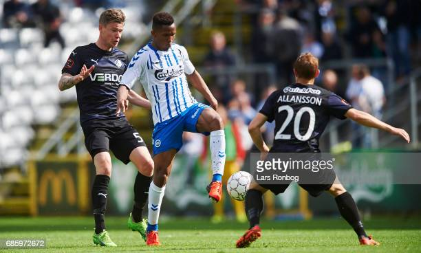 Yao Dieudonne of OB Odense Mads Agesen of Randers FC and Joel Allansson of Randers FC compete for the ball during the Danish Alka Superliga match...