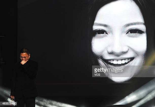 Yao Feng father of singer Bella Yao receives 'Person Of The Year' award on behalf of his daughter on February 14 2015 in Wuhan Hubei province of...