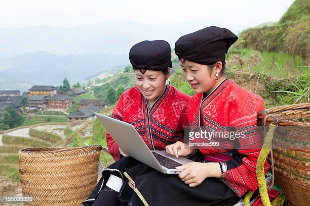 Yao Girls Using Laptop
