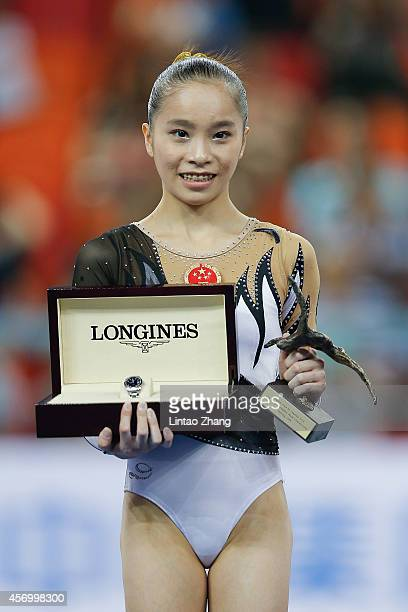 Yao Jinnan of China celebrates during the Longines most elegant athlete award in day four of the 45th Artistic Gymnastics World Championships at...