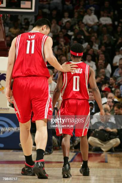 Yao Ming 7'6' center of the Houston Rockets walks up the court with teammate 6'0' guard Aaron Brooks during a break in the action against the...