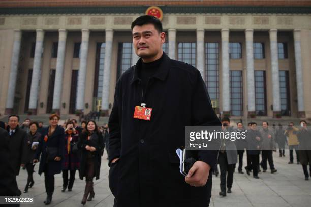 Yao Ming a former NBA basketball star and a delegate to the Chinese People's Political Consultative Conference walks outside the Great Hall of the...