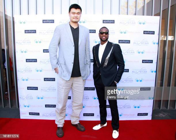 Yao Ming and Dwyane Wade attend D Wade's Apollo Jets All Star Luncheon on February 16 2013 in Houston Texas