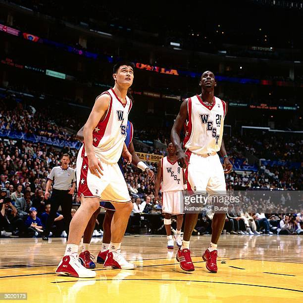 Yao Ming and Kevin Garnett of the Western Conference AllStars wait for the rebound against the Eastern Conference AllStars during the 2004 AllStar...