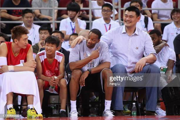Yao Ming and NBA star Tracy McGrady watch the Yao Foundation Charity Game sponsored by the charity foundation initiated by former Chinese basketball...