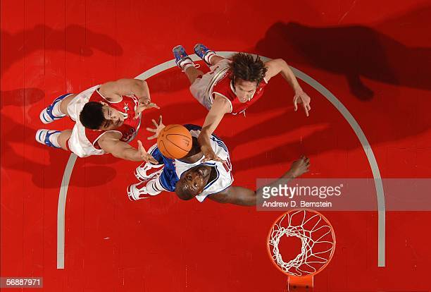 Yao Ming and Steve Nash of the Western Conference reach for a rebound against Shaquille O'Neal of the Eastern Conference during the 2006 NBA AllStar...