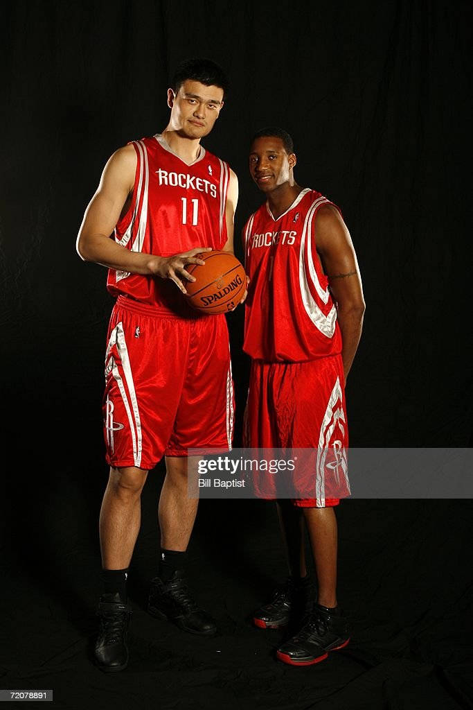Yao Ming #11 and Tracy McGrady #1 of the Houston Rockets pose during Houston Rockets Media Day on October 3, 2006 at The Toyota Center in Houston, Texas.
