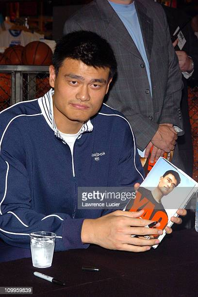 Yao Ming during Yao Ming Signs His New Book Yao A Life in Two Worlds at NBA Store in New York City New York United States