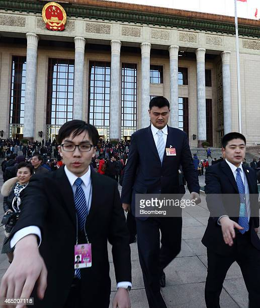 Yao Ming former National Basketball Association player center leaves the Great Hall of the People following the opening of the Chinese People's...