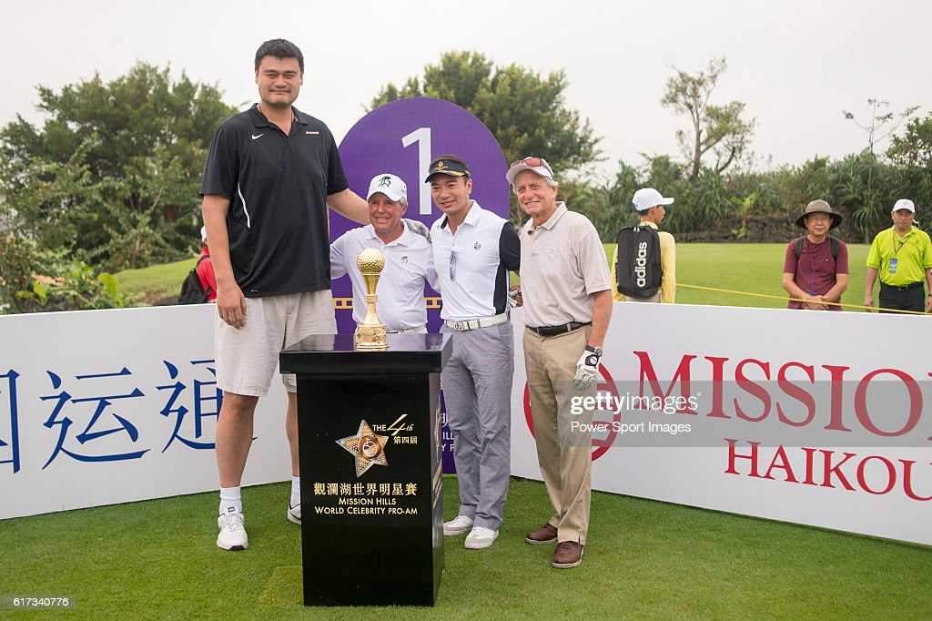 Yao Ming, Gary Player, Tenniel Chu, Michael Douglas at the 1st hole of the World Celebrity Pro-Am 2016 Mission Hills China Golf Tournament on 23 October 2016, in Haikou, Hainan province, China.