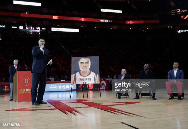 Yao Ming gives a speech during the jersey retirement ceremony at halftime of the game between the Houston Rockets and the Chicago Bulls at Toyota...