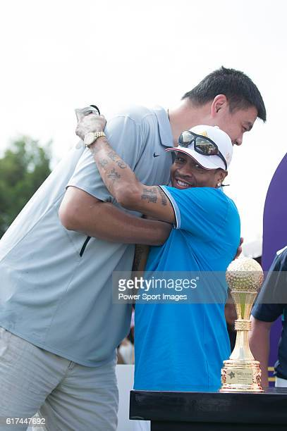 Yao Ming greets Allen Iverson at the 1st hole during the World Celebrity ProAm 2016 Mission Hills China Golf Tournament on 22 October 2016 in Haikou...
