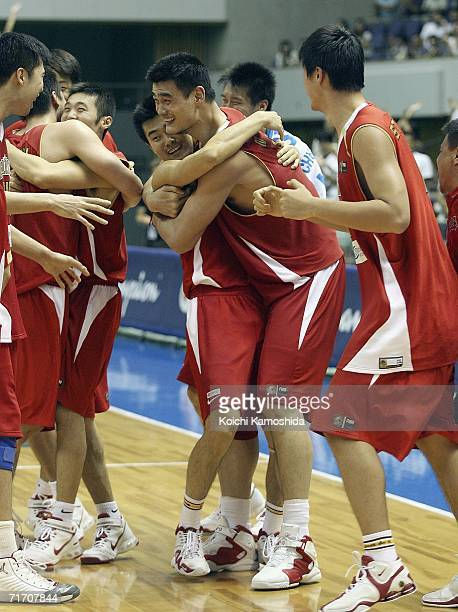 Yao Ming of China celebrates with teammate against Slovenia during the preliminary round of FIBA World Championships 2006 on August 24 2006 in...