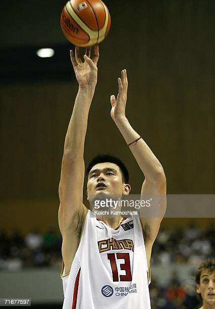 Yao Ming of Team China shoots against Team Italy during the preliminary round of the 2006 FIBA World Championships on August 19, 2006 at the Hokkaido...
