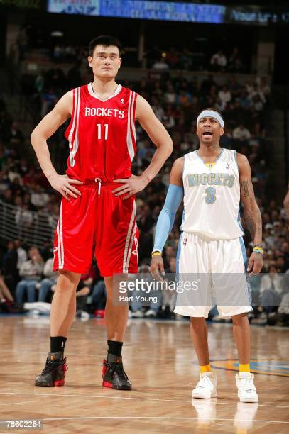 Yao Ming of the Houston Rockets and Allen Iverson of the Denver Nuggets stand together on December 20 2007 at the Pepsi Center in Denver Colorado...