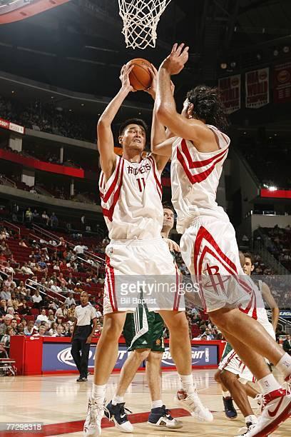 Yao Ming of the Houston Rockets and Luis Scola of the Houston Rockets go up for a rebound against Euroleague champion Panathinaikos October 11, 2007...