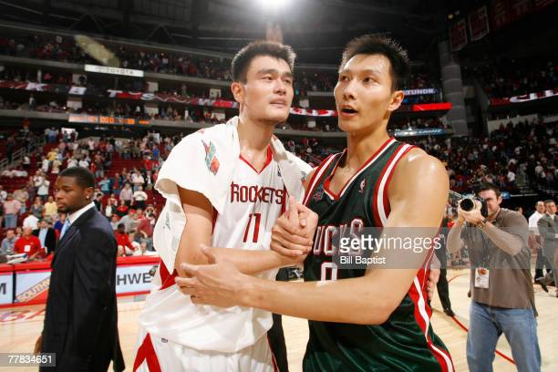 Yao Ming of the Houston Rockets and Yi Jinlian of the Milwaukee Bucks hug after the game at the Toyota Center November 9 2007 in Houston Texas NOTE...