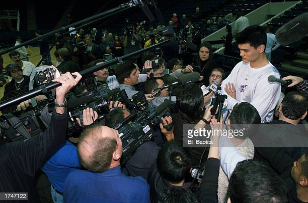 Yao Ming of the Houston Rockets answers media questions prior to the NBA game against the Los Angeles Lakers at Compaq Center on January 17 2003 in...
