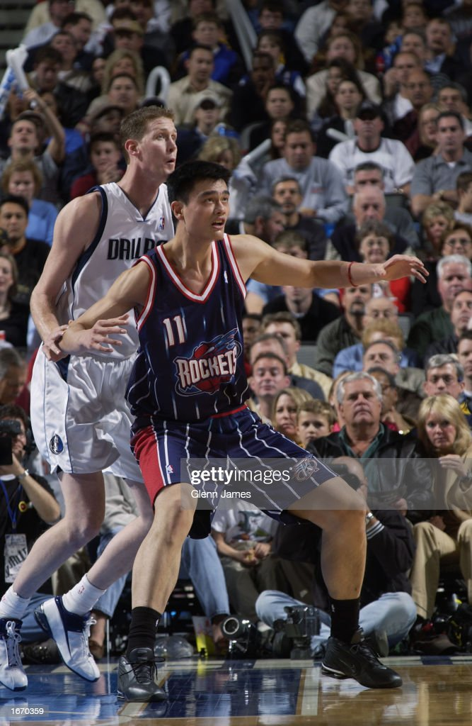 Yao Ming #11 of the Houston Rockets backs down Shawn Bradley #44 of the Dallas Mavericks during the NBA game at American Airlines Center on November 21, 2002 in Dallas, Texas. The Mavericks won 103-90.