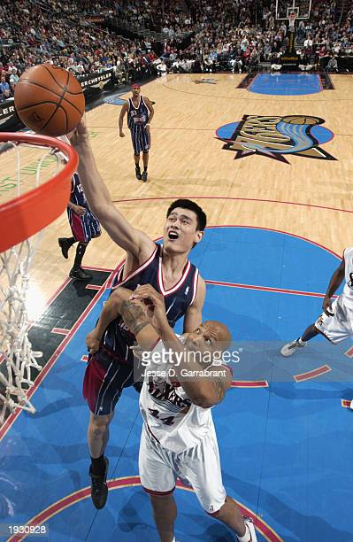 Yao Ming of the Houston Rockets battles for the shot against Derrick Coleman of the Philadelphia 76ers during the NBA game at First Union Center on...
