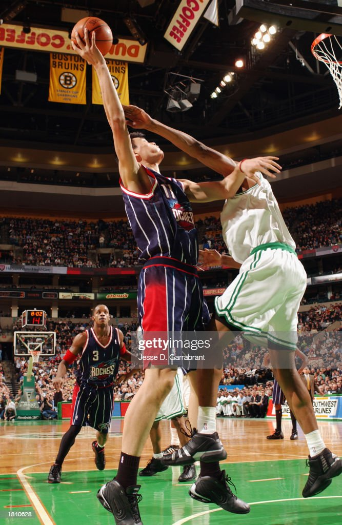 Yao Ming #11 of the Houston Rockets battles for the shot during the NBA game against the Boston Celtics at Fleet Center on February 24, 2003 in Boston, Massachusetts. The Rockets won in overtime 101-95.