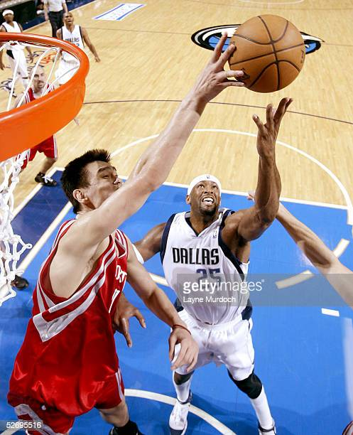 Yao Ming of the Houston Rockets blocks the shot of Erick Dampier of the Dallas Mavericks in Game two of the Western Conference Quarterfinals during...