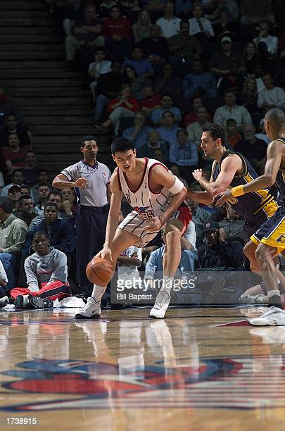 Yao Ming of the Houston Rockets dribbles against Jeff Foster of the Indiana Pacers during the game at Compaq Center on December 18 2002 in Houston...