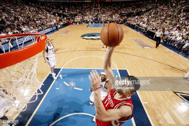 Yao Ming of the Houston Rockets dunks against the Dallas Mavericks in Game seven of the Western Conference Quarterfinals during the 2005 NBA Playoffs...